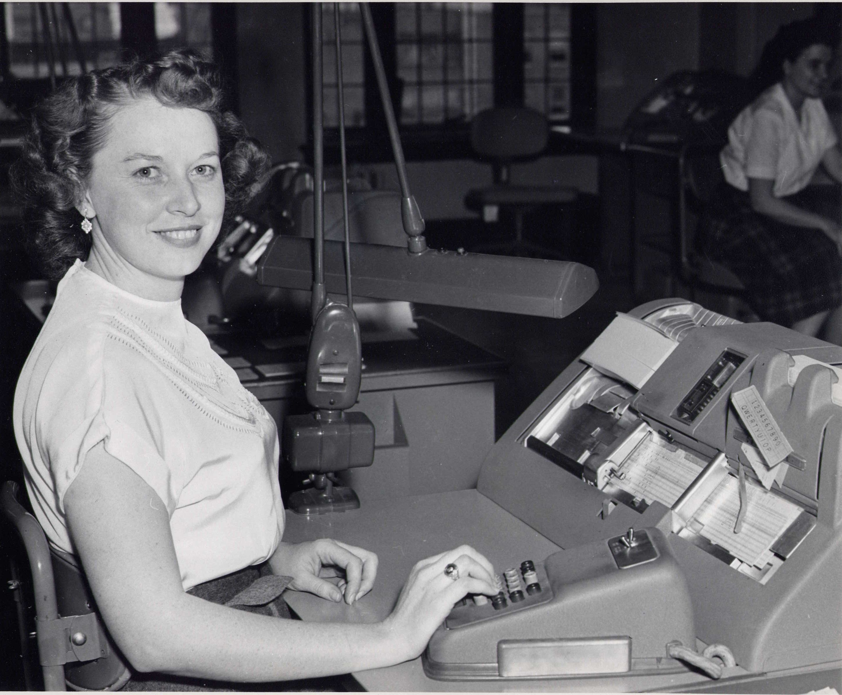 Data center. staff, emma sluder at the key punch machine. 1950's